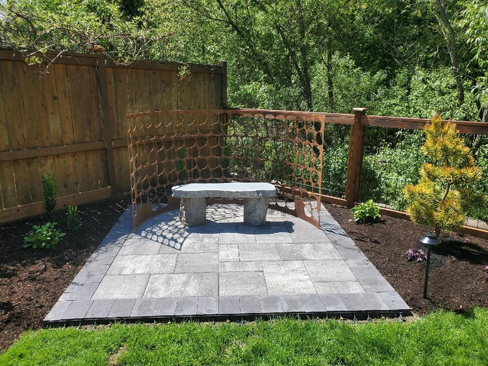 Outdoor Aesthetics landscape design stone and metal work