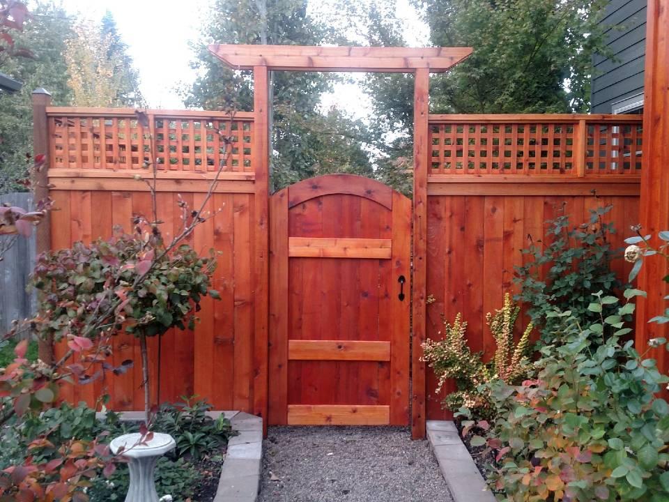 Outdoor Aesthetics landscaper cedar fence and landscape design work